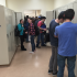 After moving in, sophomores interact at their new lockers in the alcove.