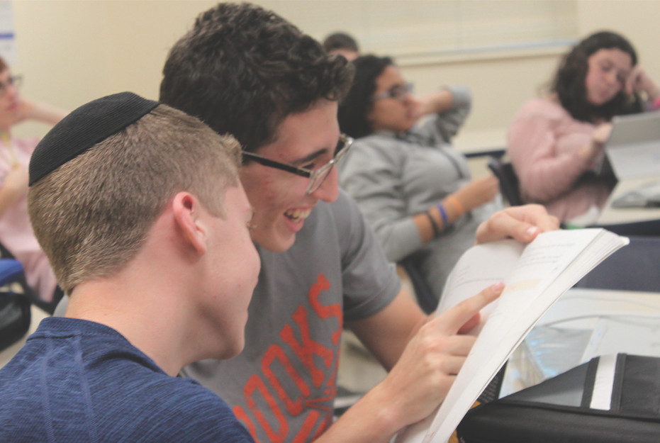 Sophomores Ari Gershengorn and Daniel Morgan study for a quiz in Arabic II. They, along with two of their classmates, tutor children of a Syrian refugee family twice a month.