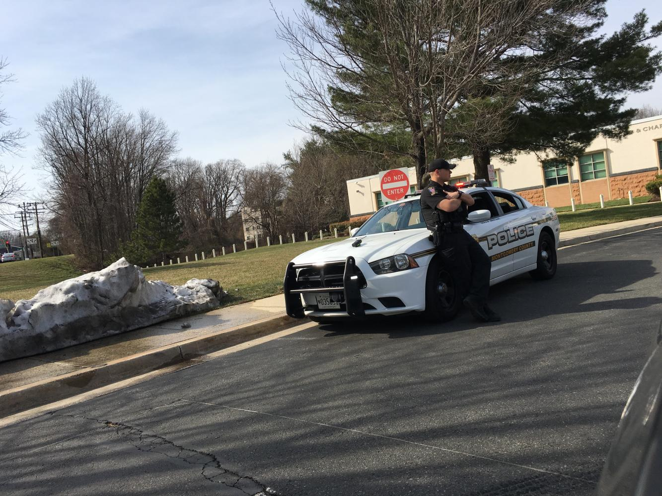 A Montgomery County police car is parked outside the Upper School. Next year, the school is planning to add increased police presence on both campuses.