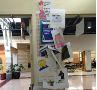 The day of elections, the bulletin board at the entrance to the freshman hallway was crowded with campaign posters advertising the many different candidates.