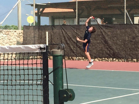 Freshman Seth Eisenstein plays tennis at the Israeli Tennis Center in Haifa on a trip to Israel with his synagogue.