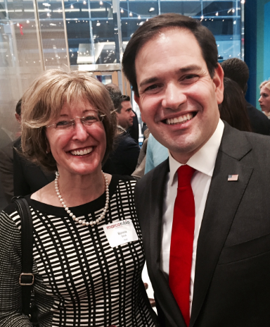 Bonnie Glick poses with her former employer, Marco Rubio. Rubio suspended his campaign on March 15.