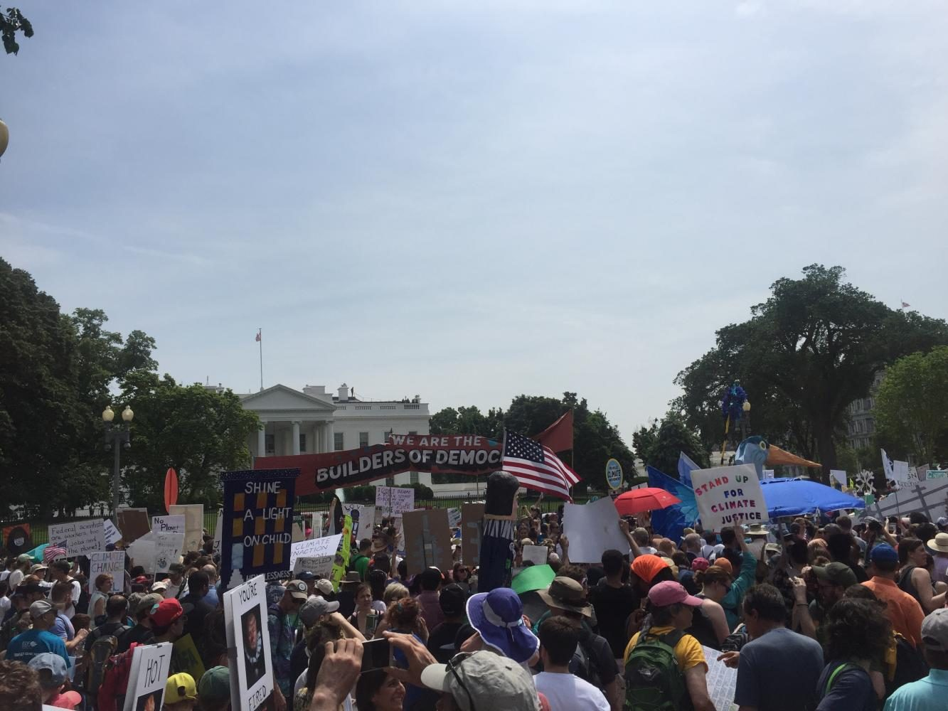 "Protesters who marched with the bloc ""Builders of Democracy"" congregate outside the front lawn of the White House at the end of the march."