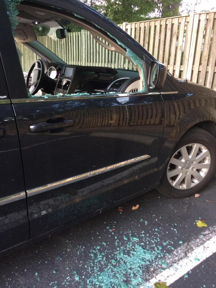 Yesterday evening, Lisa Stone parked her 2014 Chrysler Town and Country in the furthest right aisle of the parking lot. When she returned, the window was shattered and her wallet  was missing.