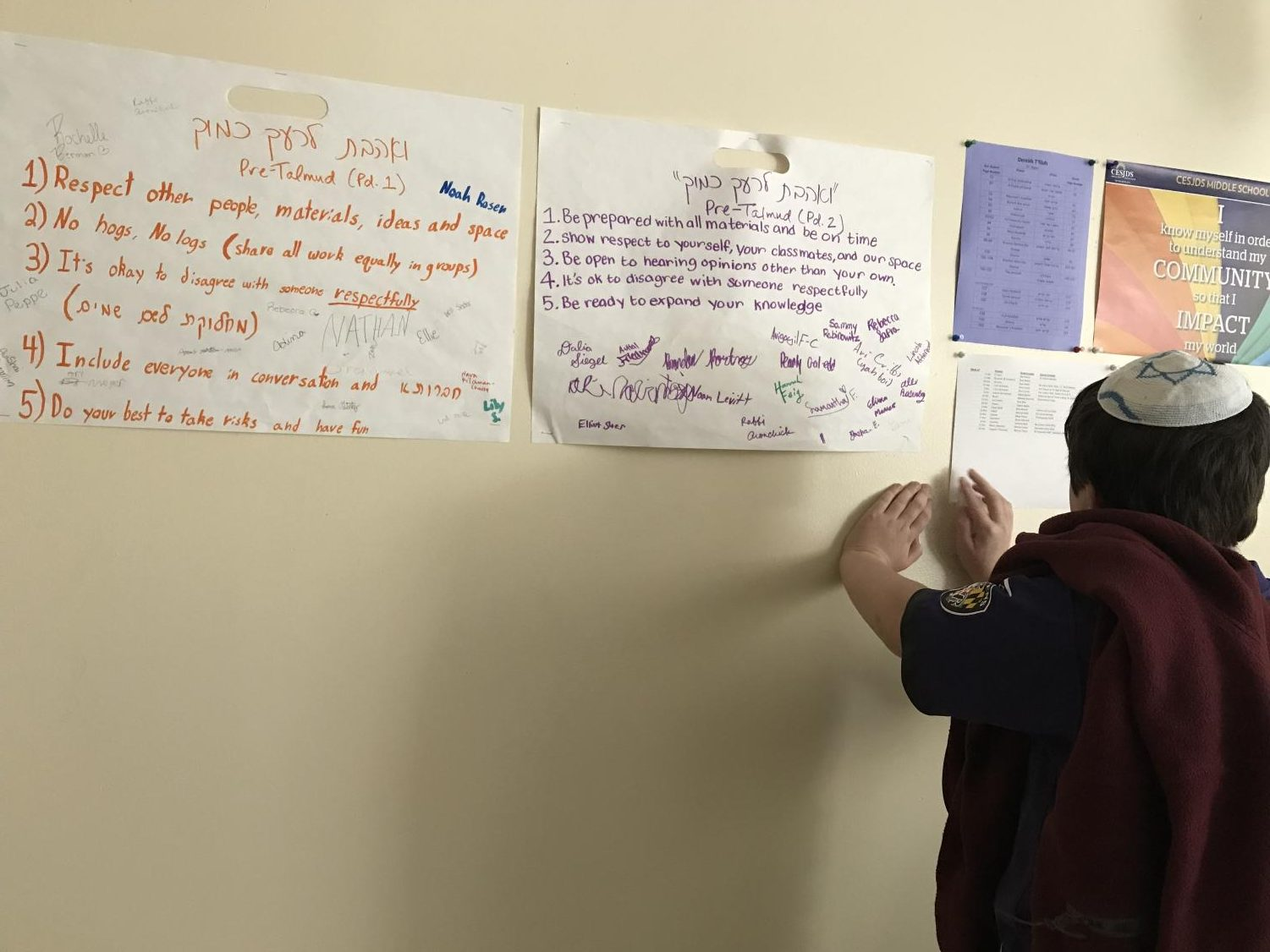 "One middle school student works on determining how the phrase ""V'Ahavta Le'Rei'akha KamoKha"" can translate into everyday school situations. The session explored the implications of loving one's neighbor as one loves oneself."