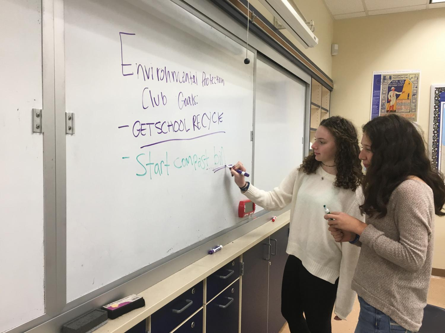 Environmental Awareness Club co-founders Dora Mendelson and Addie Bard work on possible goals that would make a more environmentally-conscious school.