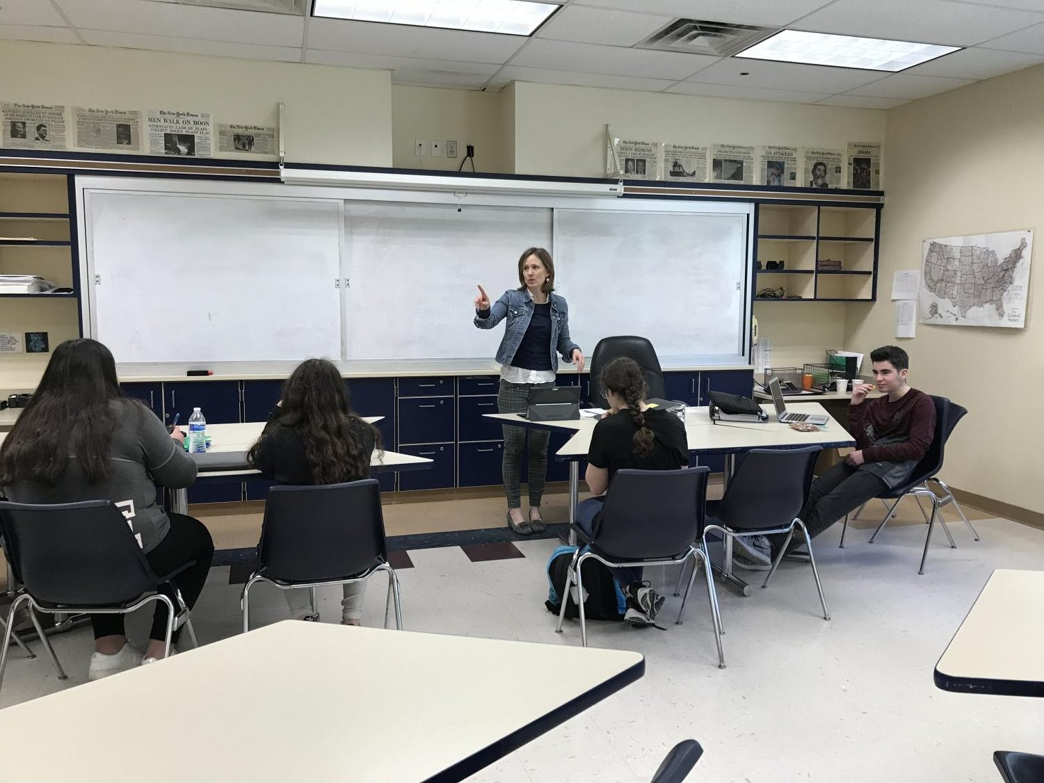 ESOL teacher Rebecca Reiser gives instructions to her students before handing out a quiz. The goal of the quiz was to help improve the students' English grammar skills.