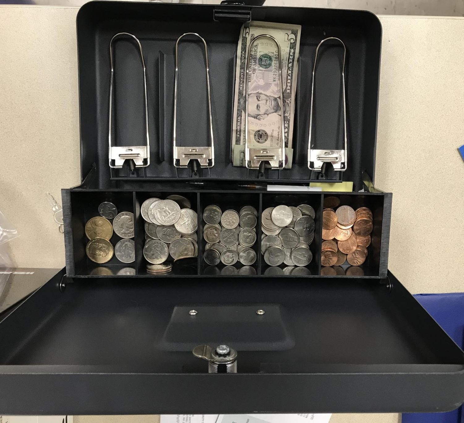 A grade government lockbox displays the class's funds collected from the fundraiser. This money can be spent on class activities and prom.