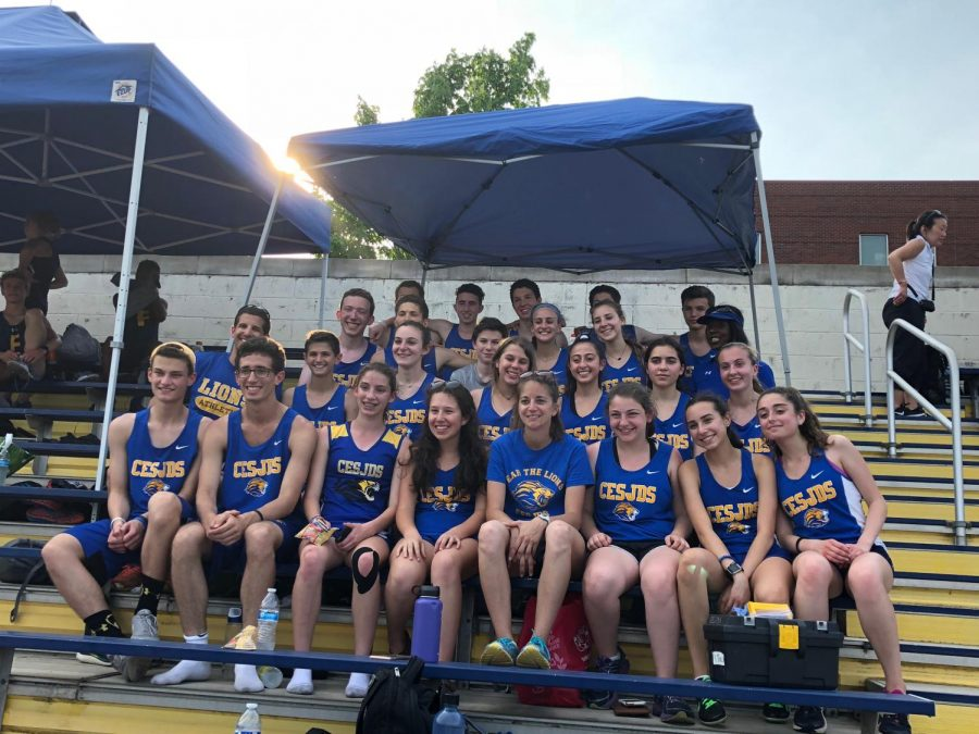 The varsity track and field team poses for a team picture at their championship meet.