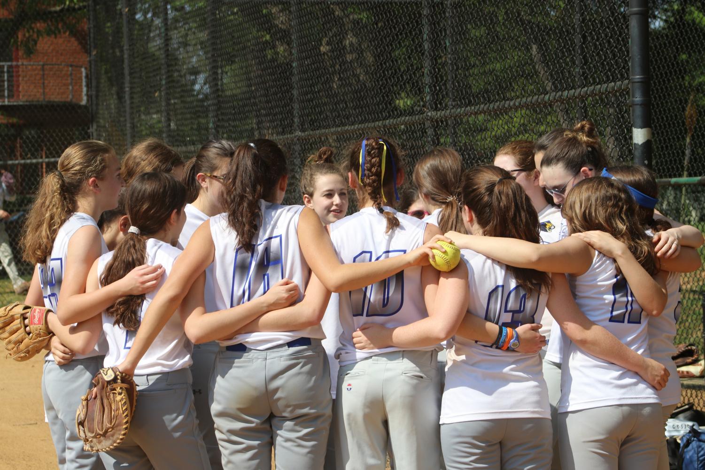 The girls softball team huddles before their game against Edmund Burke, in the PVAC semifinals.