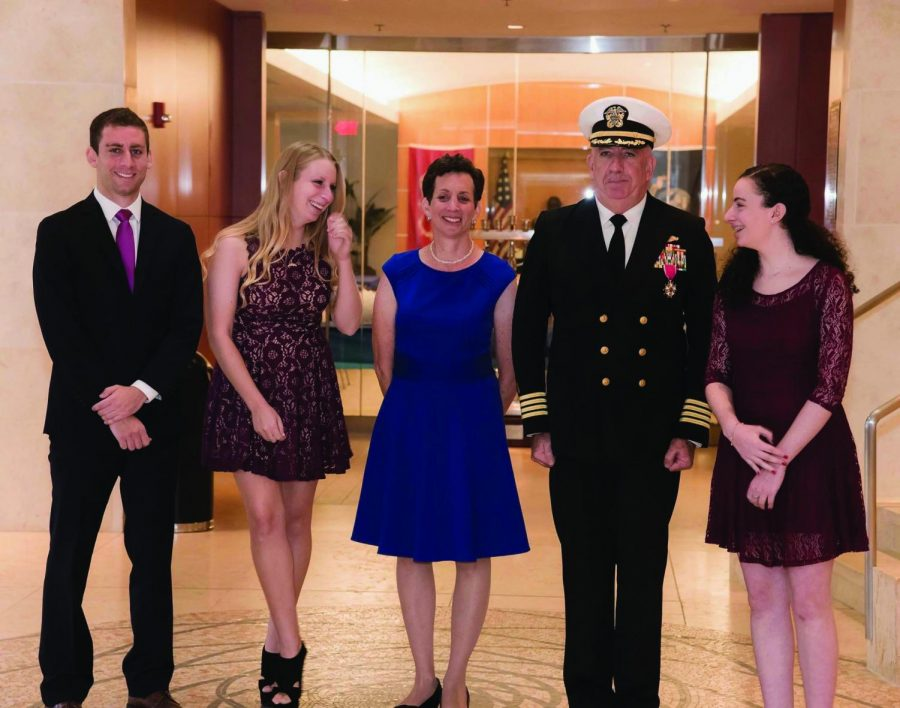 +Junior+Abby+Elson+and+her+family+celebrate+her+father%E2%80%99s+retirement+from+the+navy.+They+attended+his+retirement+ceremony+in+October+2017.+