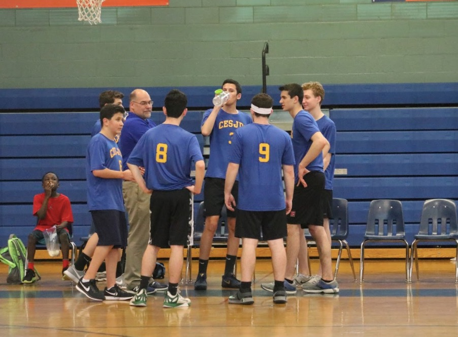 During a timeout at Hebrew Academy game, the team gathered together.