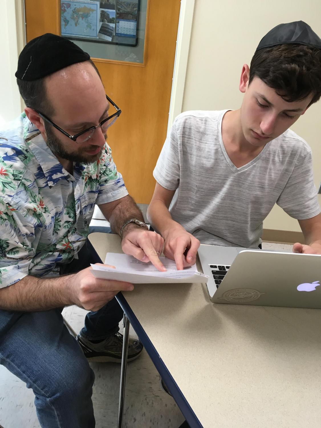 Upper School Educational Support Services teacher Brett Kugler works with sophomore Sam Fingerhut.