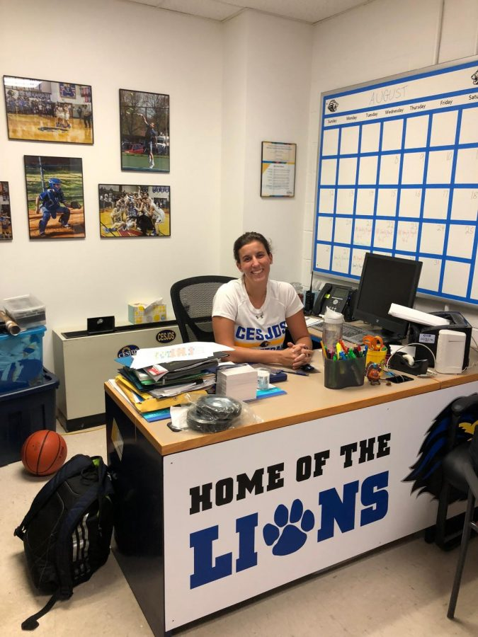 Interim+Athletic+Director+Becky+Silberman+sits+in+her+office+preparing+for+the+upcoming+school+year.