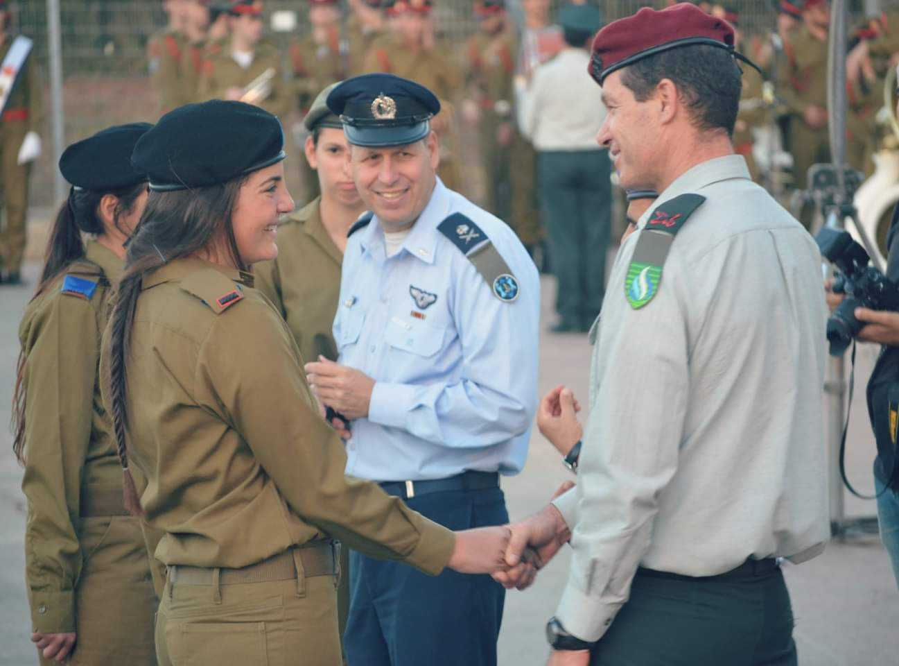 "Tal Greenberg (pictured front-left) shakes hands with high ranking officers after she completed her officer course and received her new, commissioned rank. It was a moment she said she will ""probably never forget."""