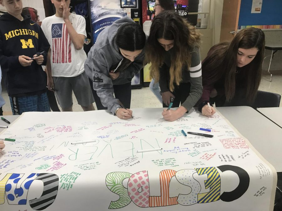 High+school+students+gather+to+sign+their+names+on+a+%22CESJDS+Cares%22+poster%2C+to+be+given+to+the+Pittsburgh+and+Tree+of+Life+synagogue+community.