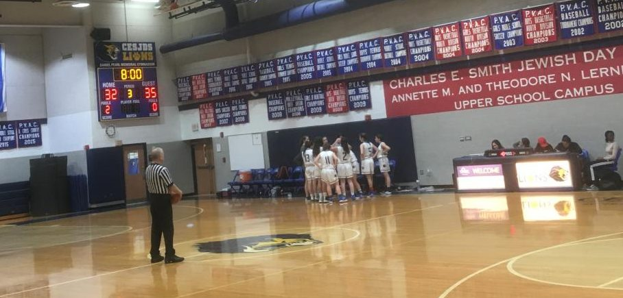 At the end of the third quarter, Lions coach Becky Silberman talks to her team about their strategy for the final quarter of a game on Dec. 5, 2018.