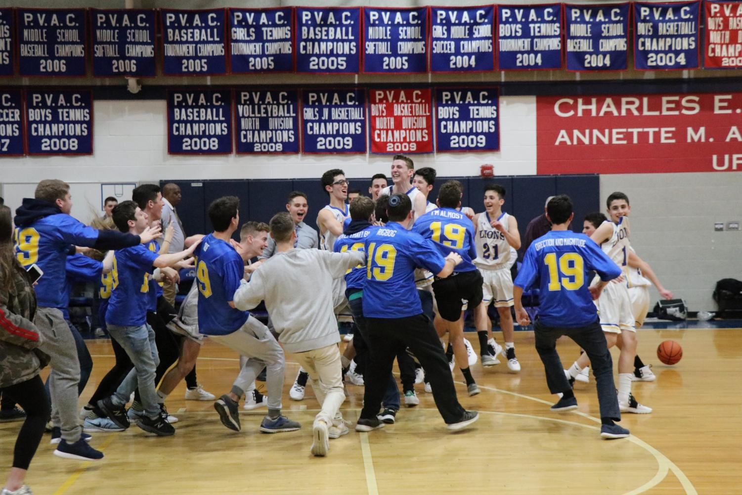 CESJDS students celebrate after a Lions win against rival school Berman Hebrew Academy.