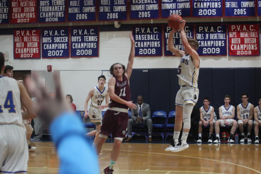Senior Dani Offer takes a jump shot in the game versus St. Anslem's Wednesday night.