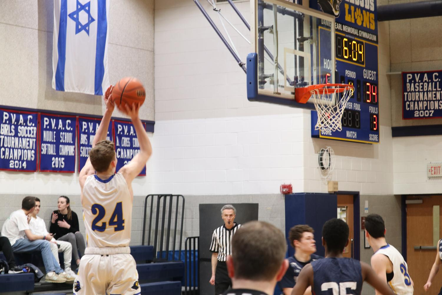 Senior and captain Zev Katz shoots a three-pointer   in the second half. Katz totaled 19 points in the game.