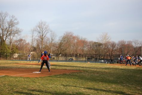 Sophomore Sasha Trainor pitches against the Berman Hebrew Academy Cougars Thursday evening in the girl's varsity softball teams' third game this season.