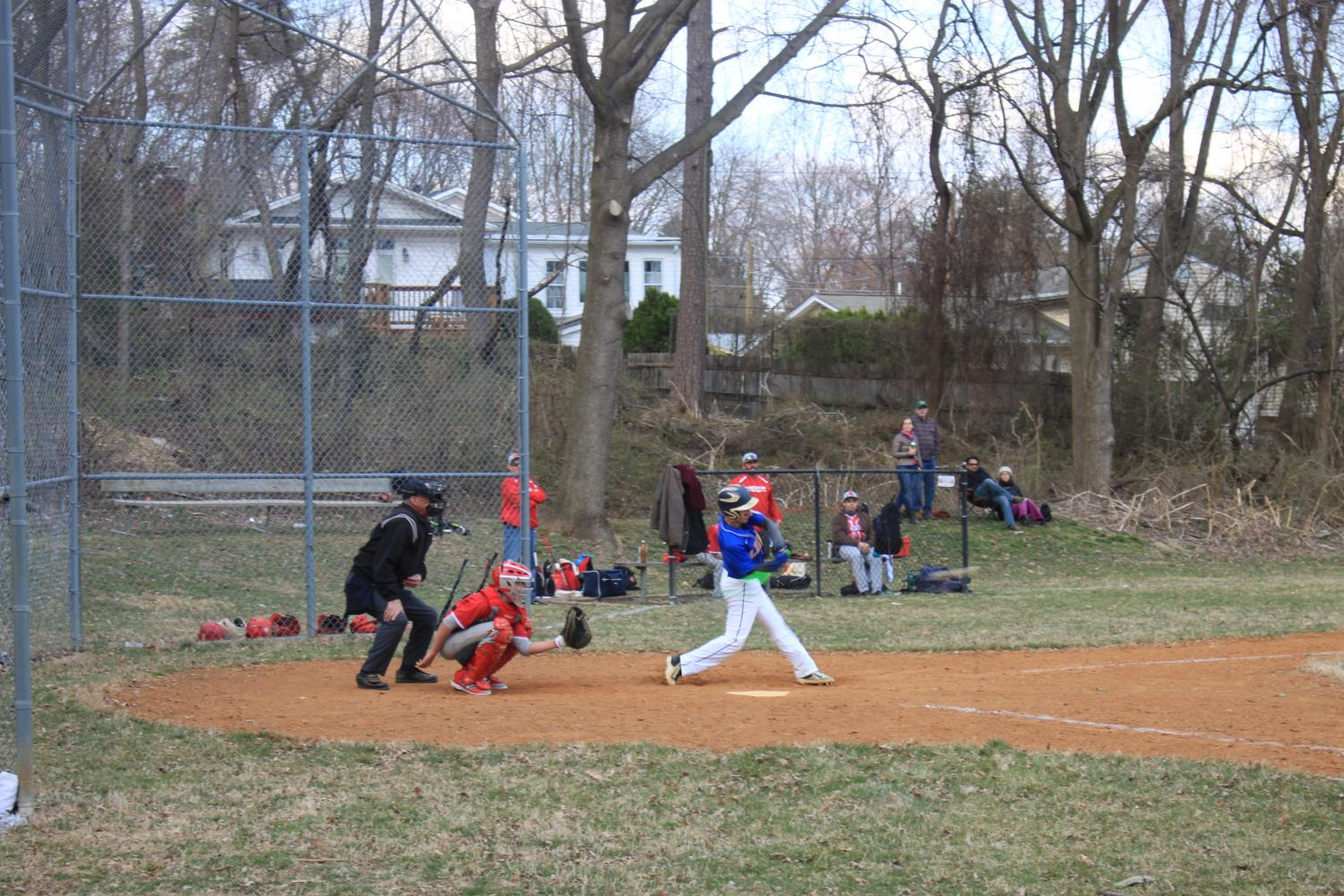 Junior third baseman Austin Kaminow hits a single in the Lions' victory over Waldorf.
