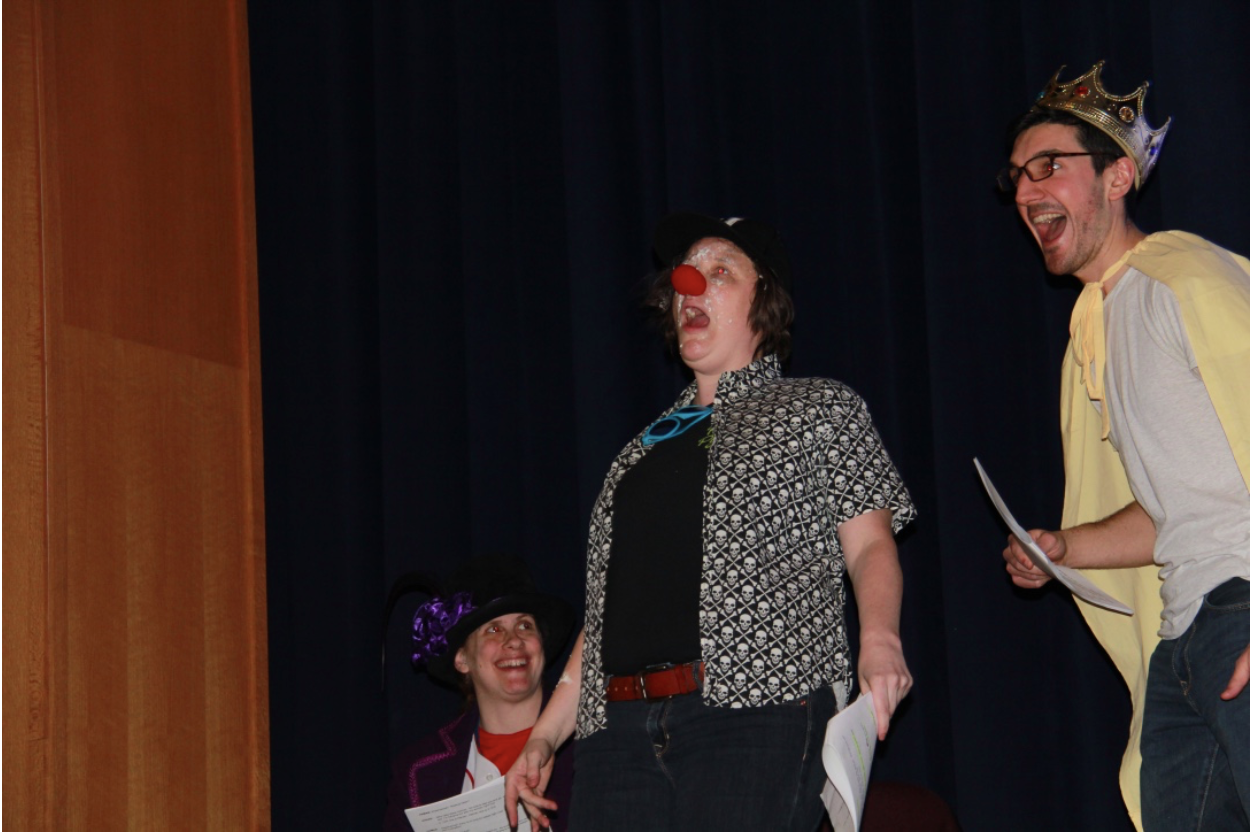 High school math teacher Tori Ball (center) organizes and plans the annual comedic Purim Spiel for the upper school each year.