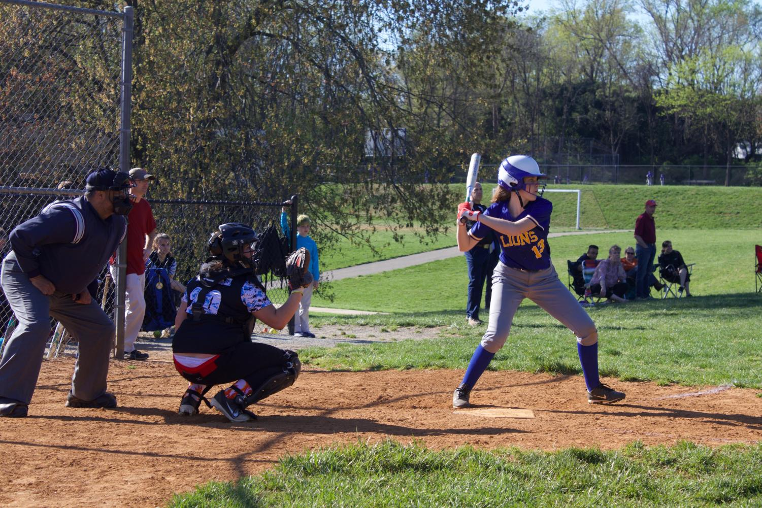 Sophomore Sasha Trainor bats against the McLean Mustangs in a game dominated by Lions offense.