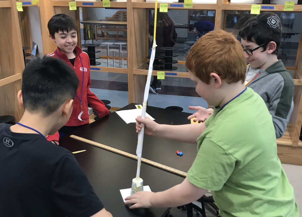 Students create a free-standing tower during the STEM event.