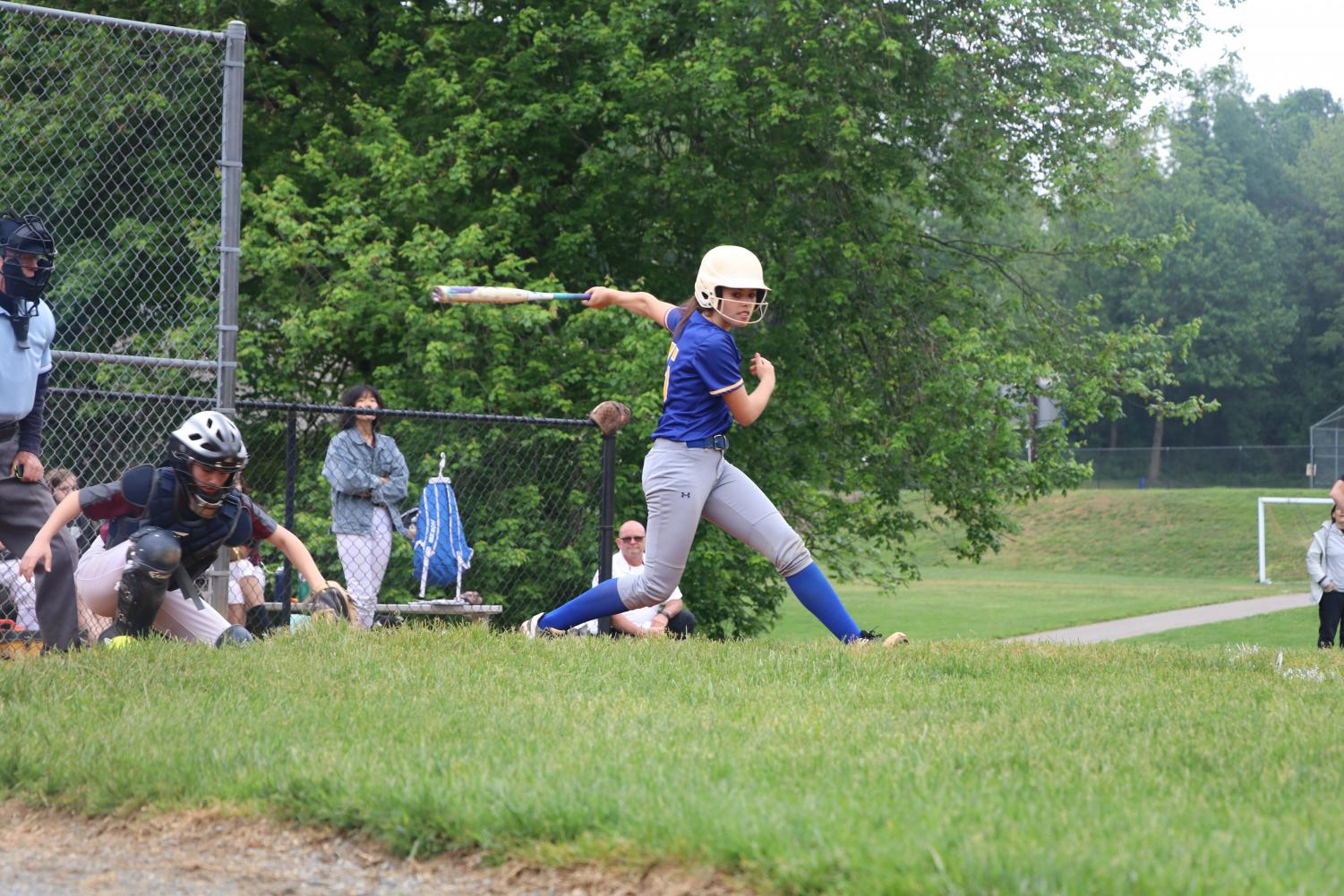 Sophomore and captain Jane Trainor swings and misses in the varsity softball semifinals against Burke.