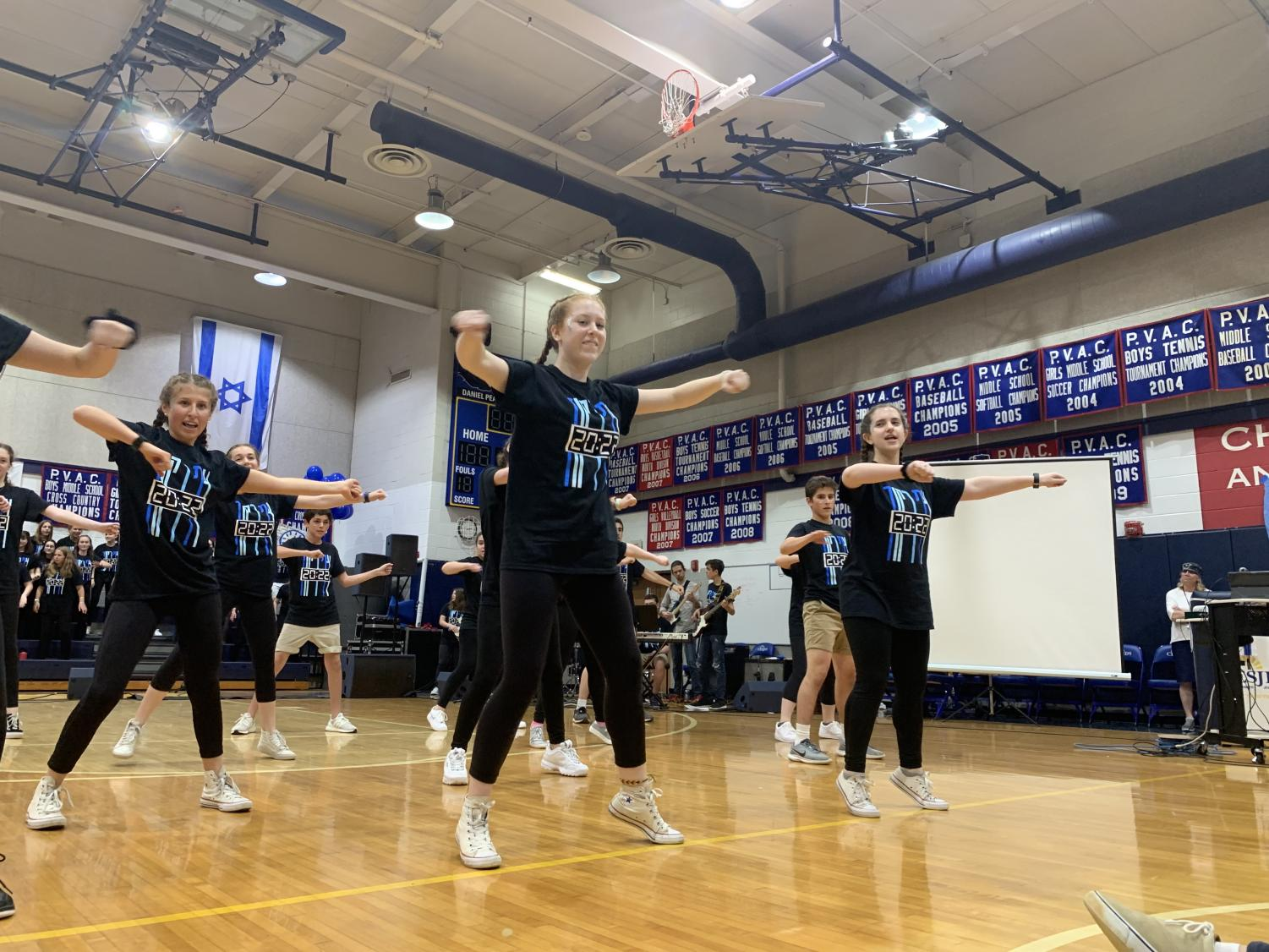 Freshman+Zoe+Wertlieb+dances+with+the+rest+of+the+freshmen+dancers+during+their+performance.+%E2%80%9CAlthough+it+is+stressful+leading+up+to+Zimriyah%2C+performing+next+to+your+friends+is+incredibly+rewarding%2C%E2%80%9D+Wertlieb+said.+