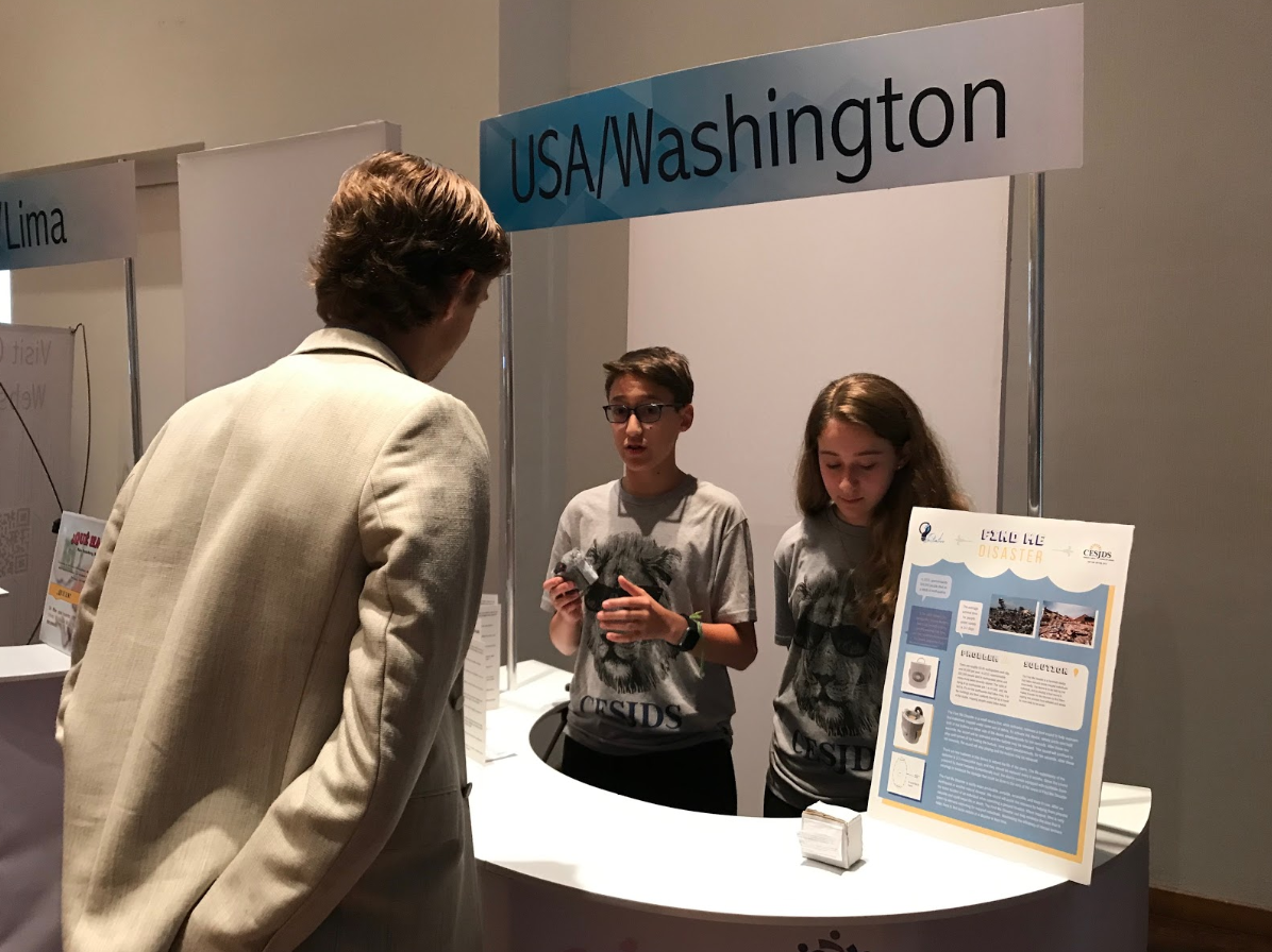 Eighth-graders Remy and Samantha Eidelman present their prototype at the international Cadena Initiative competition.