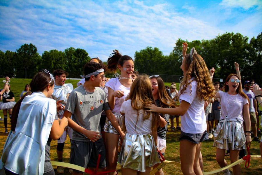 The silver team cheers ecstatically after they pulled their way to victory in the high school girls round of Tug of War.