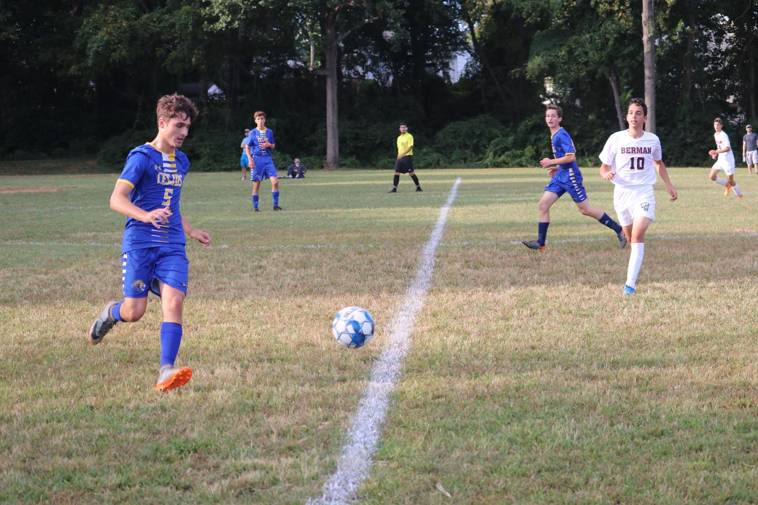 Senior co-captain Yoni Preuss runs after the ball in the boys varsity soccer game Tuesday afternoon.