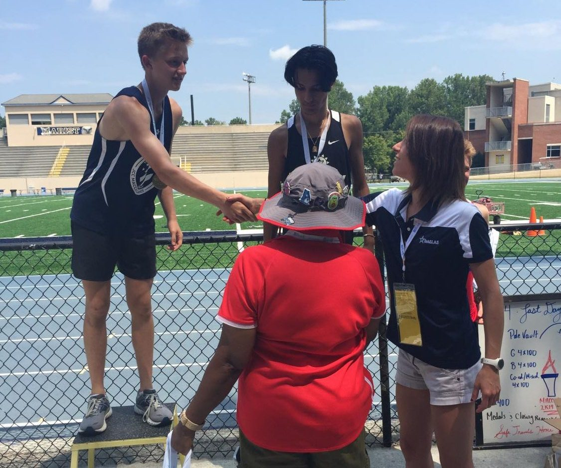 Josh Bachrach accepting one of the six medals he won at the Maccabi games in Atlanta this summer.