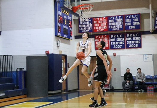 Junior Tyler Farkas attempts a layup in the game.