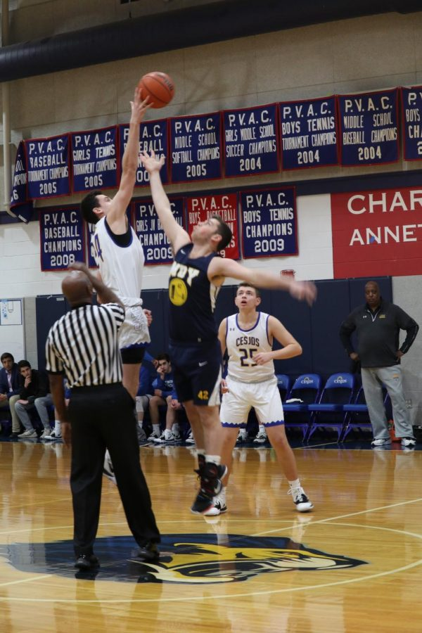 """Junior captain Jacob Rulnick won the tipoff to start the game.  """"I think we played really well. We did what we had to do defensively and it showed in the final score,"""" Rulnick said."""