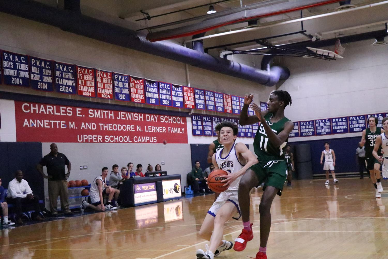 Junior Tyler Farkas attempts a layup in the boys varsity basketball game against Sandy Spring.