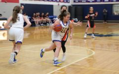 Girls and boys teams defeat Berman Cougars in second matchups of season