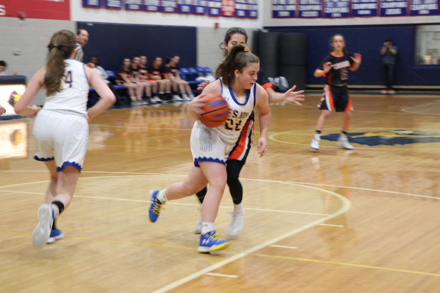 Sophomore Avital Friedman dribbles the ball as she attempts to run past the Cougars to the net.