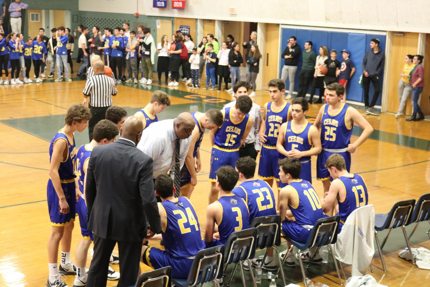 The Lions huddle with their head coach, David McCloud.