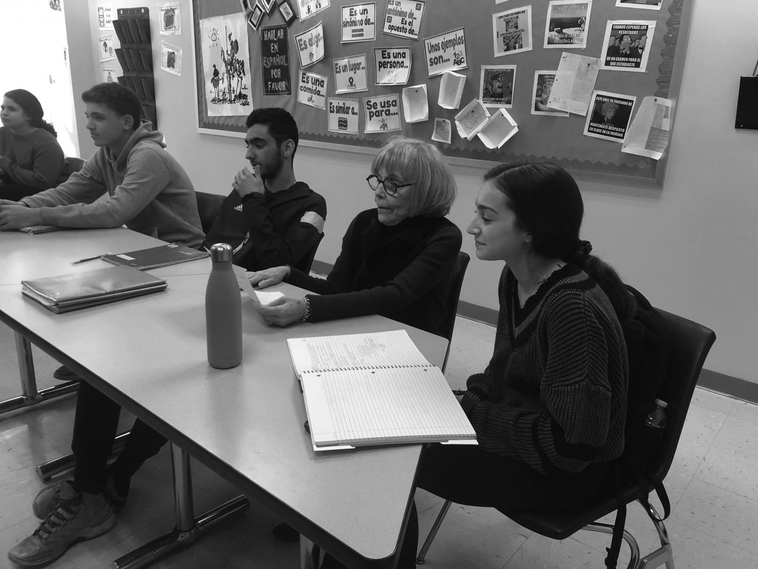 Dean of Students Roslyn Landy sits in on a senior math class and observes the learning experience. In addition to shadowing students, administrators regularly sit in on classes to evaluate teachers.