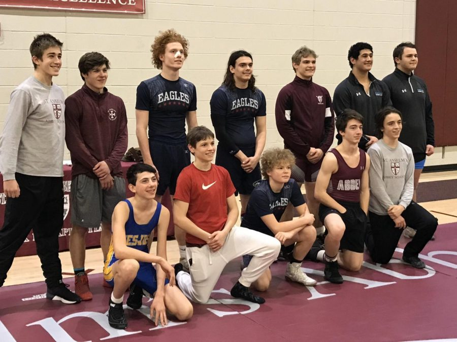 Freshman Oliver Ferber [front left] poses with fellow Potomac Valley Athletic Conference champions after winning his weight class.