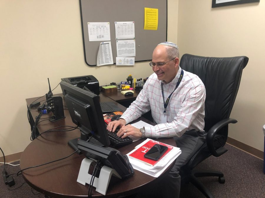 High School Principal and Associate Head of School Dr. Marc Lindner sits at his desk to work. After four years at JDS, Linder is leaving to be the head of school at a Jewish day school in Los Angeles.