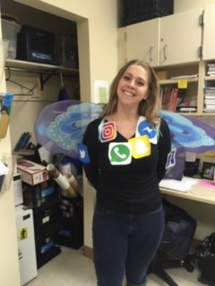 English teacher Ms. Naomi Allemann wears social media icons on Purim last year.