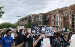Wearing masks as they march through downtown Bethesda, Maryland, peaceful protesters advocate for racial justice in the U.S.
