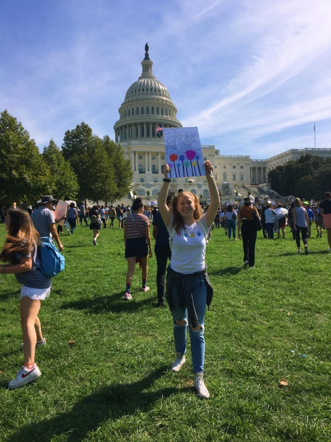Junior Zoe Wertlieb stands in front of the Capitol during a climate change march.