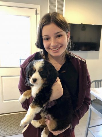 Dalia Greenblum holds her new dog, Kingston.