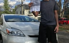 Junior Lincoln Aftergood holds up his license after passing the new Maryland driver's test.