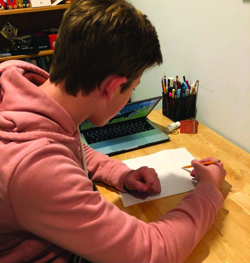 Sophomore Jonah Gross prepares to take a test.